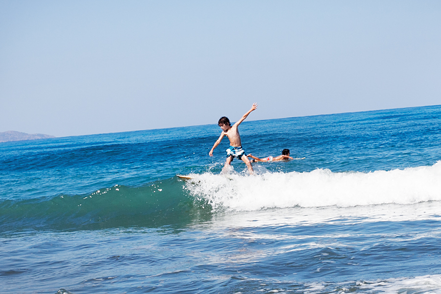 north-cyprus-child-surfing-on-the-sea