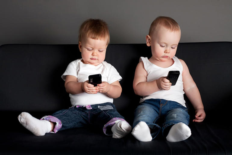 cellphone-children-sitting-sofa-north-cyprus