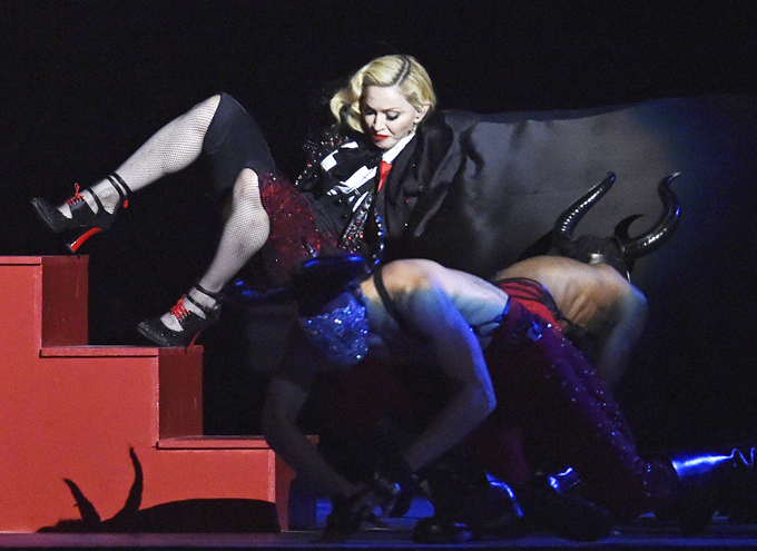 Singer Madonna falls during her performance at the BRIT music awards at the O2 Arena in Greenwich, London