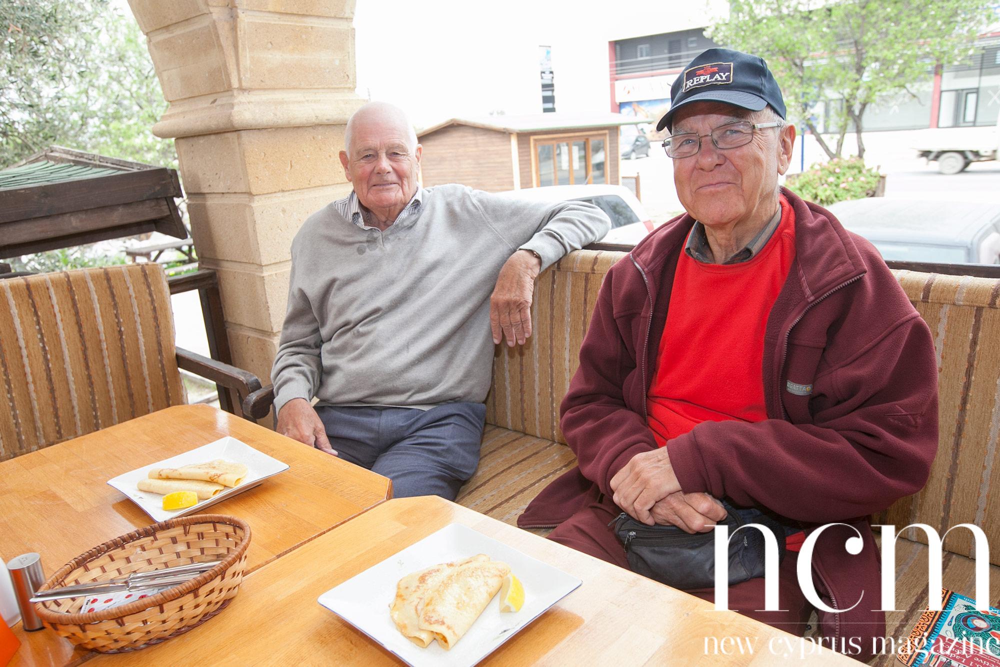 Men with Pancakes at Food Lodge